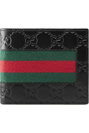 Gucci Brieftasche aus Signature Leder mit Webstreifen