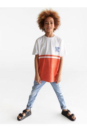 Zara Zweifarbiges shirt mit schriftzug