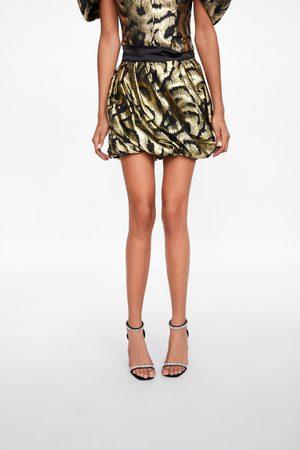 Zara Minirock mit metallic-faden