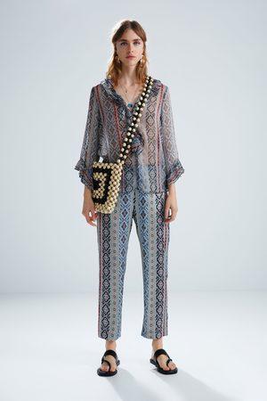 Zara Damen Hosen & Jeans - Hose mit print