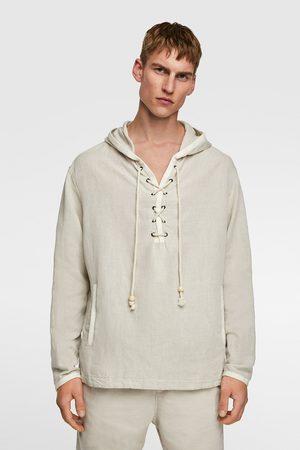 Zara Jacke aus festem stoff mit bauchtasche