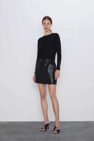 Zara Minirock aus kunstleder mit taschen