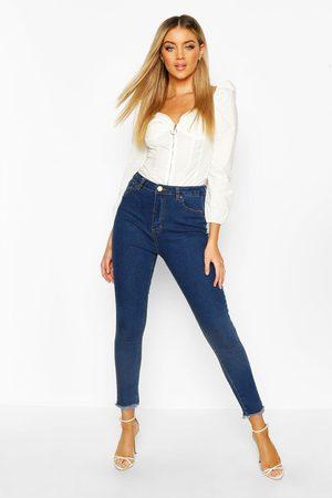 Boohoo Womens Skinny Jeans mit ausgefranstem Saum - - 32