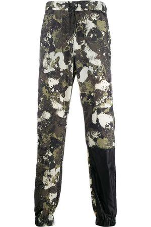 MARCELO BURLON Herren Jogginghosen - Hose mit Camouflage-Print