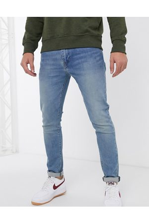 Levi's 512 – Schmale Karottenjeans in mittlerer Pelican Rust-Waschung