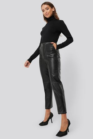 Erica Kvam x NA-KD Faux Leather Front Seam Pants - Black