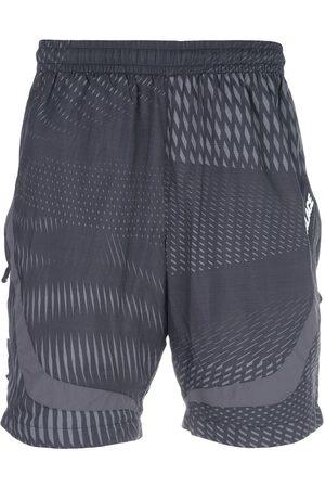 PALACE Herren Kurze Hosen - Shorts mit grafischem Print