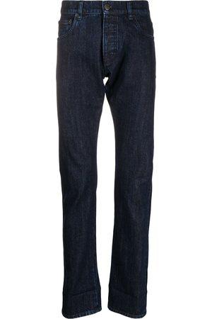 Prada Herren Straight - Gerade Jeans mit Logo-Schild