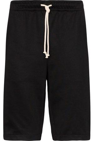 Gucci Joggingshorts mit GG-Streifen