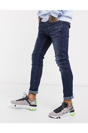 Levi's – Youth 519 Hi-Ball Roll –Superenge Jeans aus Advanced-Stretch in dunkler Can Can-Waschung