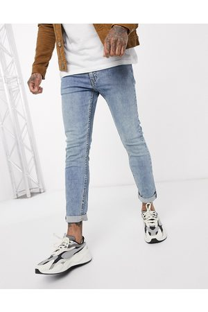 Levi's – Youth 519 Hi Ball Roll – Super enge Jeans mit Advanced Stretch in heller Pickles-Waschung