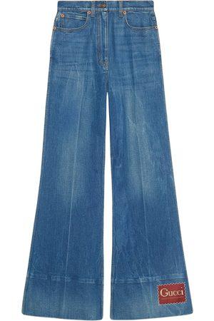 Gucci Ausgestellte Jeans mit Logo-Patch