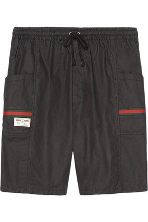 Gucci Knielange Shorts mit Webstreifen
