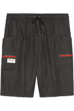 Gucci Shorts aus beschichteter Baumwolle mit Etikett
