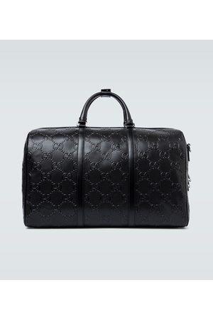 Gucci Geprägte Reisetasche aus Leder