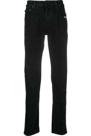 OFF-WHITE Skinny-Jeans mit diagonalen Streifen