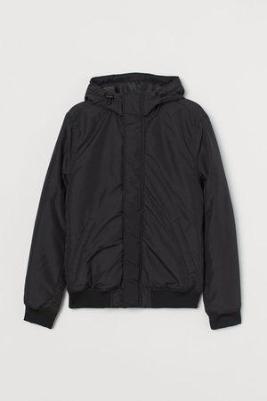 H&M Wattierte Jacke mit Kapuze