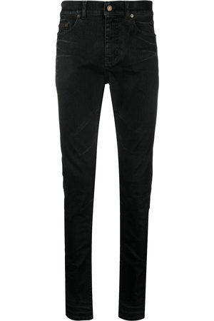 Saint Laurent Herren Skinny - Beschichtete Skinny-Jeans