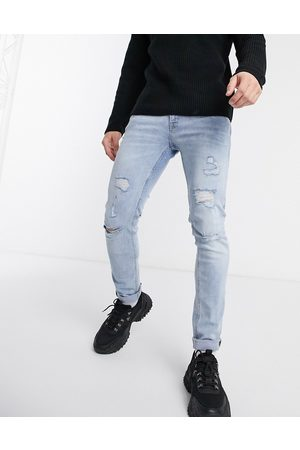 Jack & Jones Intelligence – Liam – Enge Jeans aus Superstretch-Material im Used-Look in heller Waschung