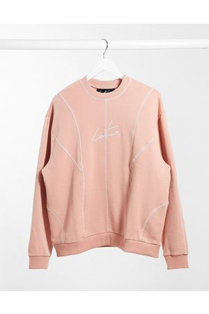 The Couture Club – Oversize-Sweatshirt mit Bahnendesign in