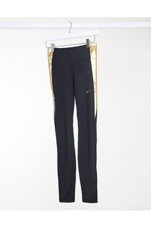 Nike – Enge Leggings in und Gold