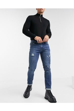 ASOS Enge Jeans im Used-Look in dunkelblauer Vintage-Waschung