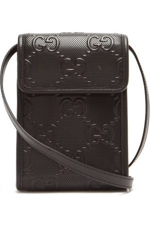 Gucci Gg-logo Quilted Leather Cross-body Bag