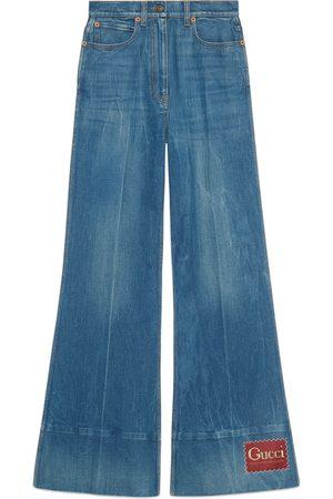 Gucci Schlaghose aus Denim mit Waschung und Etikett
