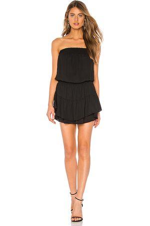 krisa Smocked Strapless Mini Dress in . Size XS, S, M.