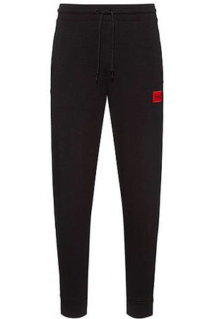 HUGO BOSS Cotton tracksuit bottoms with red logo patch