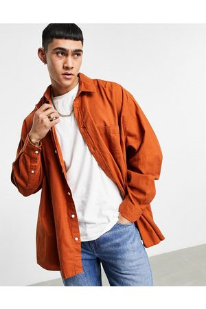 ASOS – Rostrotes Flanellhemd in extremer Oversize-Passform