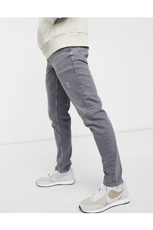 ASOS – Schmale Jeans in im Used-Look