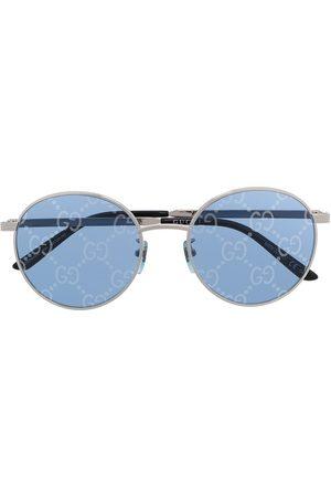 Gucci Runde Sonnenbrille mit GG-Gläsern