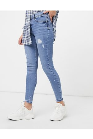 River Island – Amelie – Jeans im engen Schnitt im Distressed-Look in hellem Authentic