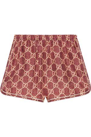 Gucci Shorts aus Seide mit GG Supreme-Print