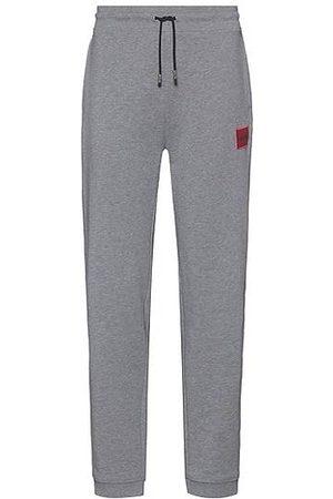 HUGO BOSS Damen Lange Hosen - Jogginghose aus Baumwoll-Terry mit rotem Logo-Etikett