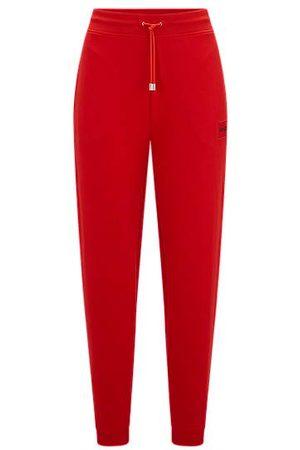 HUGO Damen Jogginghosen - Jogginghose aus Baumwoll-Terry mit rotem Logo-Etikett