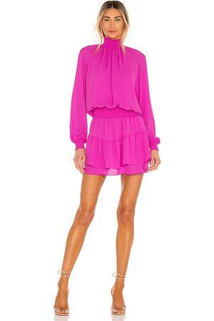 krisa Turtleneck Ruffle Skirt Dress in . Size XS, S, M.