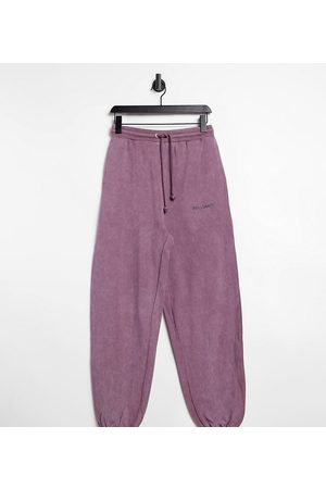 COLLUSION Unisex – Oversized-Jogginghose in Acid-Waschung in Lila, Kombiteil