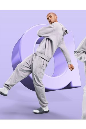 ASOS ASOS – Dark Future – Lockere Jogginghose in fliederfarbener Waschung mit Logo-Lila
