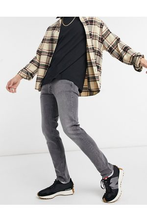 Jack & Jones Intelligence – Glenn – Karottenjeans in mit schmaler Passform