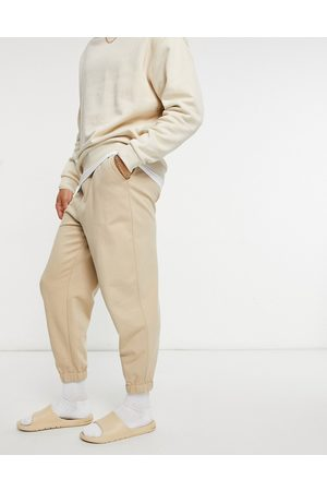 ASOS – Oversized-Jogginghose aus Bio-Materialien in -Neutral