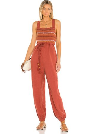Free People Sienna Smocked Jumpsuit in . Size M, S, XS.