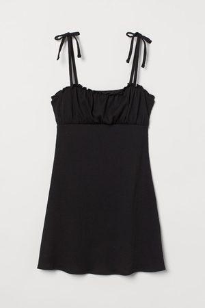 H&M Jerseykleid mit Schleifen
