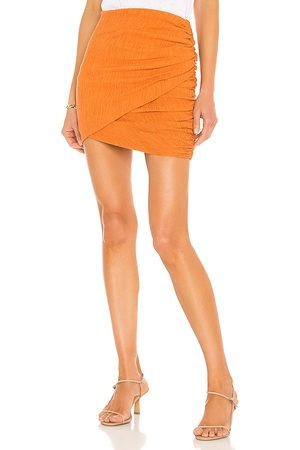Camila Coelho Tais Mini Skirt in . Size XXS, XS, S, M, XL.
