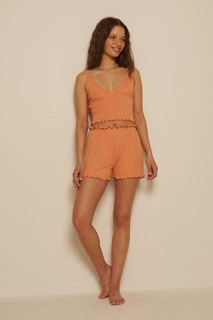 NA-KD Recycelt Babylock Mini-Shorts - Orange