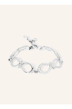 TAMARA COMOLLI Unser SIGNATURE Armband mit seinem fließenden Tropfendesign trägt sich elegant und weich zu jedem Anlass. Ein blitzender Diamanttropfen sorgt für Extraglanz. Stufenlos verstellbar, baumelt ein zusätzlicher kleiner Tropfen am Ende. 18 Karat
