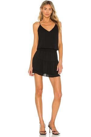 krisa Smocked Cami Mini Dress in . Size XS, S, M.