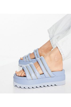 ASOS Wide Fit – Thea – Mules in mit Plateausohle