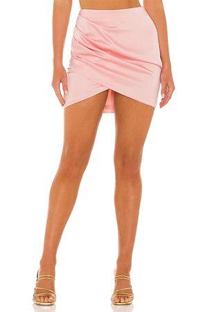 NBD Rose Quartz Mini Skirt in . Size XXS, XS, S, M, XL.